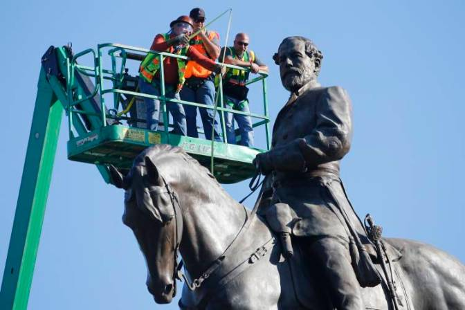 An inspection crew from the Virginia Department of General Services takes measurements as they inspect the statue of Confederate Gen. Robert E. Lee on Monument Avenue in Richmond, VA.